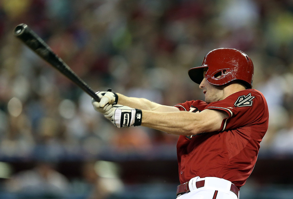 . Josh Wilson #10 of the Arizona Diamondbacks hits a RBI double against the Colorado Rockies during the fourth inning of the MLB game at Chase Field on April 28, 2013 in Phoenix, Arizona.  (Photo by Christian Petersen/Getty Images)