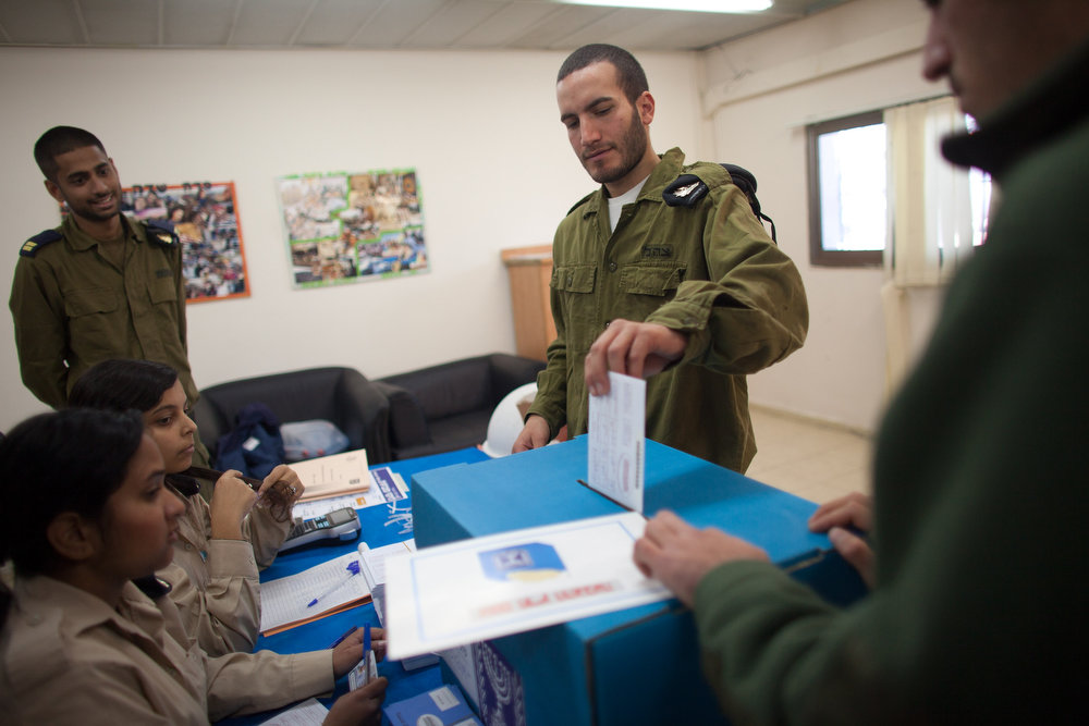 Description of . An Israeli Navy soldier casts his vote at an army Navy base on January 20, 2013 in Ashdod, Israel. Israeli soldiers have voted ahead of the Israeli general elections that will be held on January 22. The IDF votes before the rest of the country to make sure that every soldier has a chance to cast a ballot. (Photo by Uriel Sinai/Getty Images)