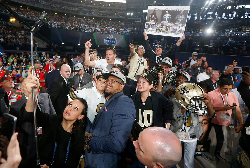 . UTSA\'s Marcus Davenport, center, celebrates by taking a selfie with New Orleans Saints fans after being selected by the team during the first round of the NFL football draft, Thursday, April 26, 2018, in Arlington, Texas. (AP Photo/Michael Ainsworth)