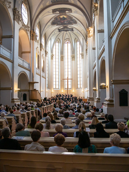 The grand view: audience, chorus, orchestra, and church.