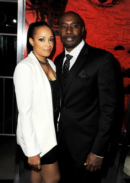 ". Actor Morris Chestnut (R) and his wife Pam Byse arrive at the premiere of Tri Star Pictures\' ""The Call\"" at the Arclight Theatre on March 5, 2013 in Los Angeles, California.  (Photo by Kevin Winter/Getty Images)"