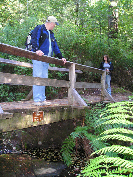 Paul and Linda cross one of many bridges on the Shadowbrook Trail where it crisscrosses Union Creek.