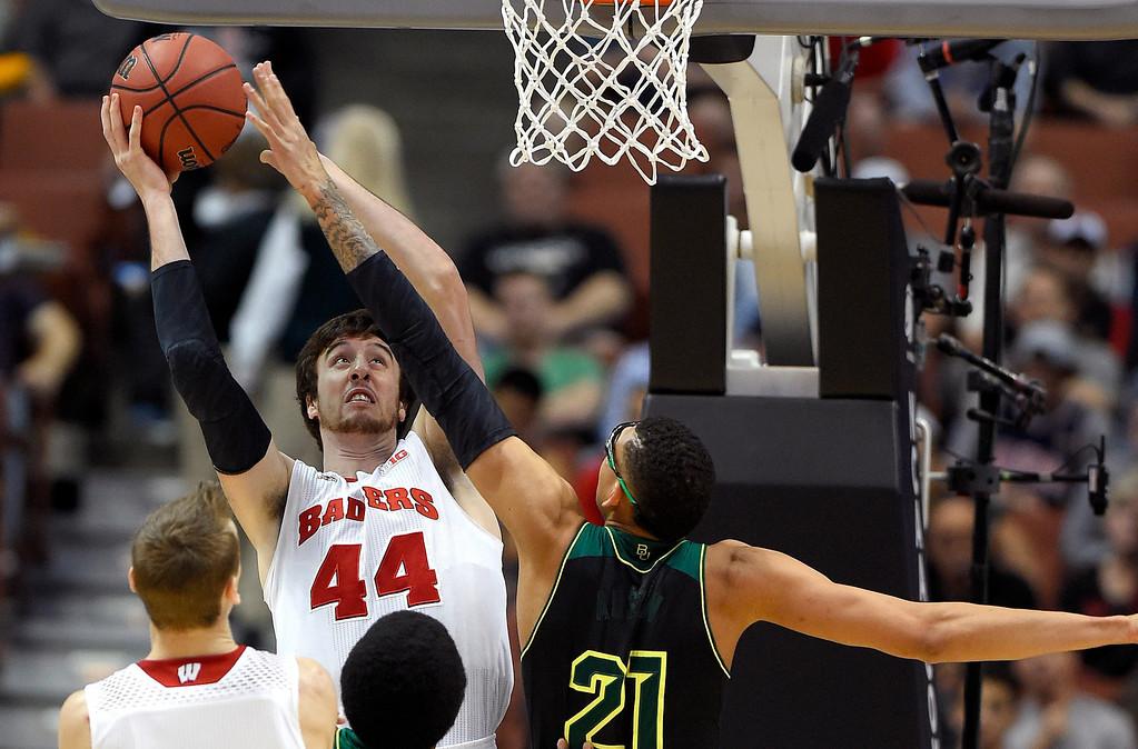 . Wisconsin forward Frank Kaminsky (44) shoots over Baylor center Isaiah Austin (21) during an NCAA men\'s college basketball tournament regional semifinal, Thursday, March 27, 2014, in Anaheim, Calif. (AP Photo/Mark J. Terrill)