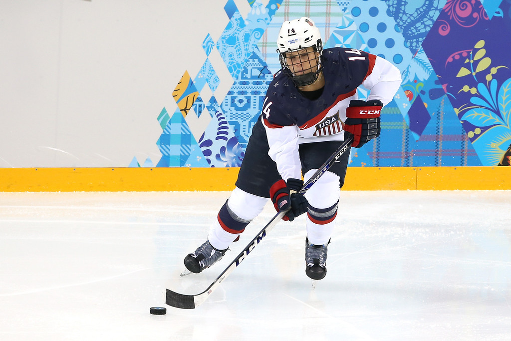 . Brianna Decker #14 of the United States handles the puck against Canada during the Women\'s Ice Hockey Preliminary Round Group A game on day five of the Sochi 2014 Winter Olympics at Shayba Arena on February 12, 2014 in Sochi, Russia.  (Photo by Bruce Bennett/Getty Images)