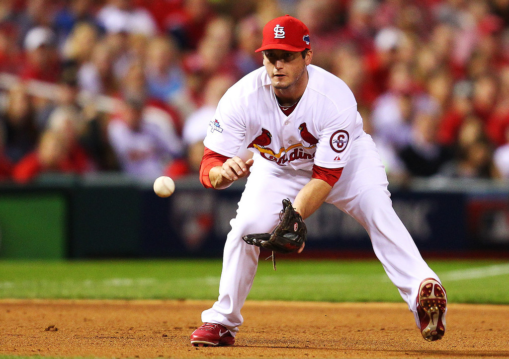 . David Freese #23 of the St. Louis Cardinals fields a ground ball for a fourth inning out against the Pittsburgh Pirates during Game Five of the National League Division Series at Busch Stadium on October 9, 2013 in St Louis, Missouri.  (Photo by Dilip Vishwanat/Getty Images)