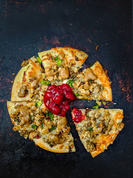 Christmas pizza with gravy slice out whole.jpg