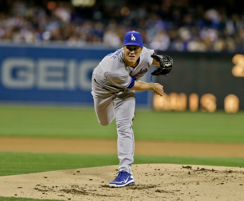 . Los Angeles Dodgers starting pitcher Zack Greinke pitches against the San Diego Padres during the first inning of a baseball game in San Diego, Thursday, April 11, 2013. (AP Photo/Lenny Ignelzi)