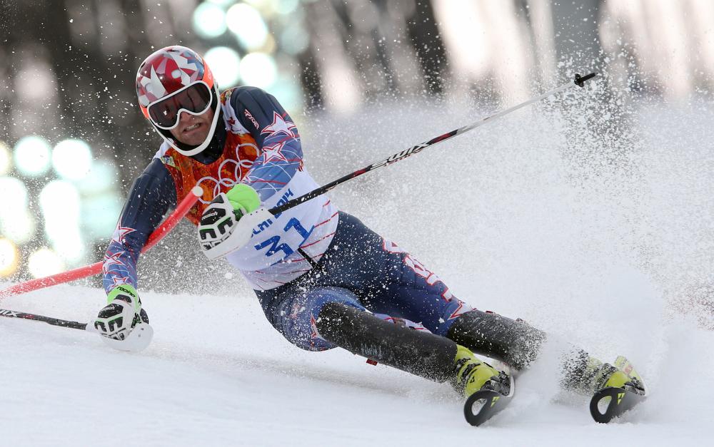 . United States\' Nolan Kasper skis during the first run of the men\'s slalom at the Sochi 2014 Winter Olympics, Saturday, Feb. 22, 2014, in Krasnaya Polyana, Russia.(AP Photo/Luca Bruno)