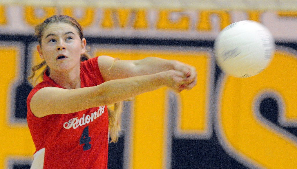 . Redondo girls volleyball takes on Bishop Montgomery in a non league match in Torrance on 09/10/2013. Redondo won 3-0. A spiked ball deflect off Redondo\'s Petra Grutzik and goes out of bounds. (Photo by Scott Varley, Daily Breeze)