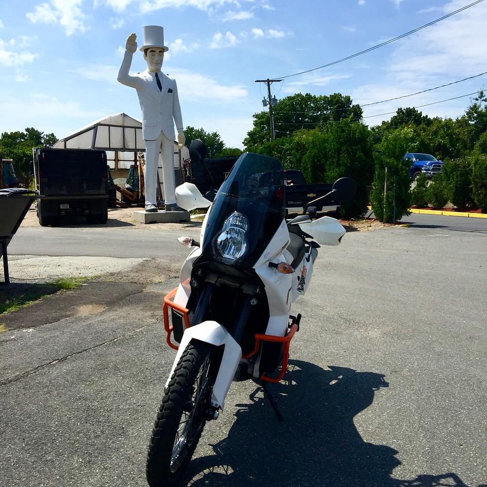 big white guy muffler man agawam - texaco big friend - ktm 990 baja motorcycle