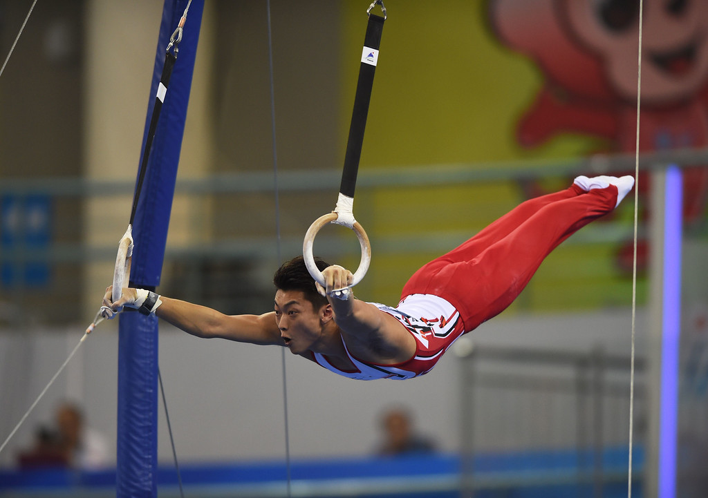 . Japan\'s Kohei Kameyama competes on the rings during the men\'s qualification at the Gymnastics World Championships in Nanning, in China\'s southern Guangxi province on October 4, 2014. GREG BAKER/AFP/Getty Images