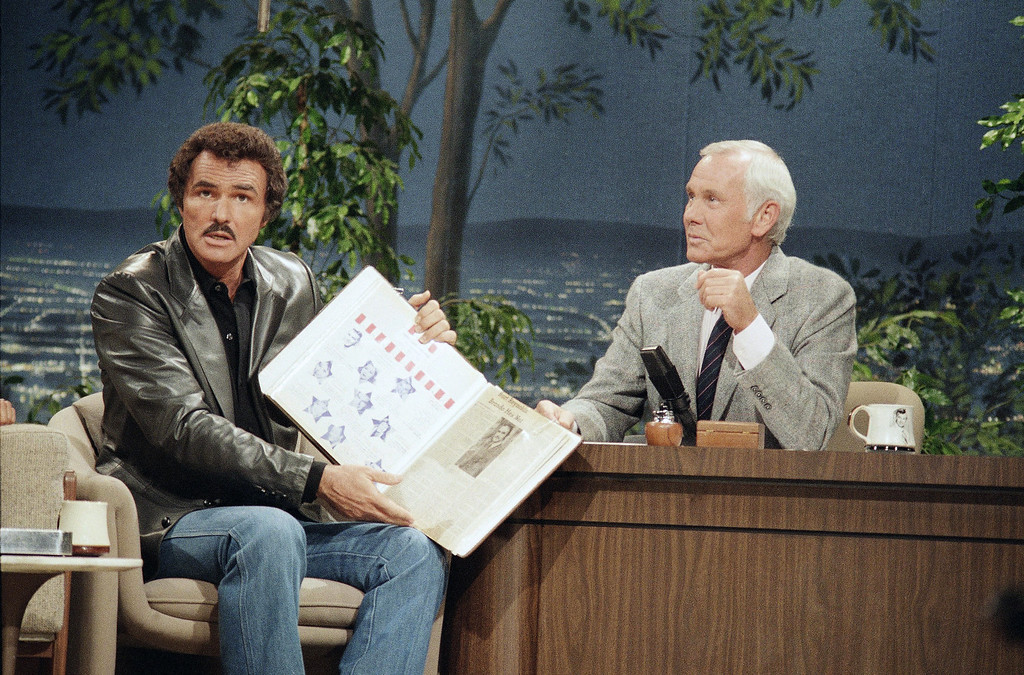 . Actor Burt Reynolds displays scrapbook while making appearance on ?The Tonight Show Starring Johnny Carson,? Thursday, Sept. 6, 1985 in Burbank. The scrapbook was compiled by Reynolds? mother. According to NBC-TV, Reynolds told Carson that he feels good and is in good health. (AP Photo/NBC)