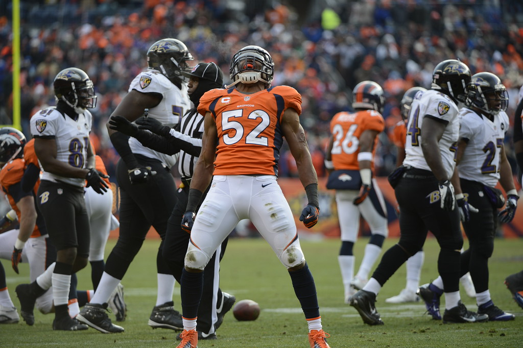 . Denver Broncos outside linebacker Wesley Woodyard (52) celebrates after taking down Baltimore Ravens running back Ray Rice (27) during the second quarter.  The Denver Broncos vs Baltimore Ravens AFC Divisional playoff game at Sports Authority Field Saturday January 12, 2013. (Photo by Hyoung Chang,/The Denver Post)