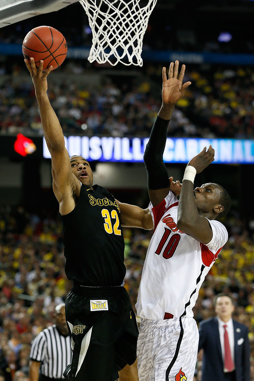 . ATLANTA, GA - APRIL 06:  Tekele Cotton #32 of the Wichita State Shockers goes up for a shot against Gorgui Dieng #10 of the Louisville Cardinals in the first half during the 2013 NCAA Men\'s Final Four Semifinal at the Georgia Dome on April 6, 2013 in Atlanta, Georgia.  (Photo by Kevin C. Cox/Getty Images)