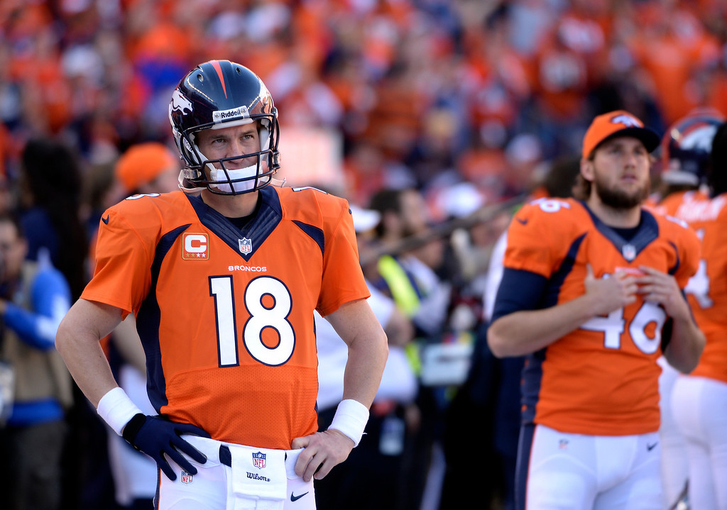 . Broncos quarterback Peyton Manning (18) waits to take the field during the third quarter against the New England Patriots in the AFC Championship game on January 19, 2014. (Photo by Helen Richardson/The Denver Post)