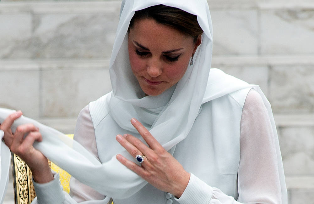 Description of . Britain's Prince William's wife Catherine, the Duchess of Cambridge adjusts her scarf outside a mosque at KLCC in Kuala Lumpur on September 14, 2012, on the second leg of a nine-day Southeast Asian and Pacific tour marking Queen Elizabeth II's Diamond Jubilee. AFP PHOTO / Saeed  KHAN/AFP/Getty Images