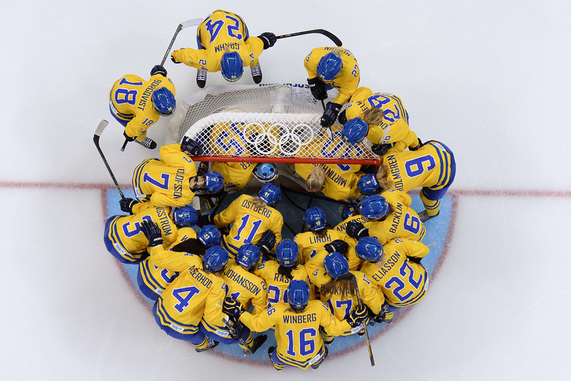 . Sweden\'s team gathers around their goalkeeper before the Women\'s Ice Hockey Semifinals Sweden vs USA at the Shayba Arena during the Sochi Winter Olympics on February 17, 2014.   AFP PHOTO / JONATHAN NACKSTRANDJONATHAN NACKSTRAND/AFP/Getty Images