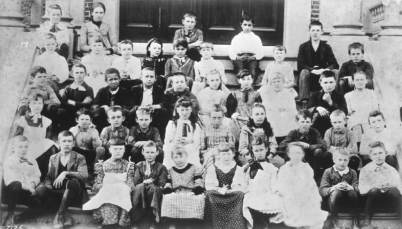 Portrait of pupils on the steps of the Spring Street School, Los Angeles, ca.1890