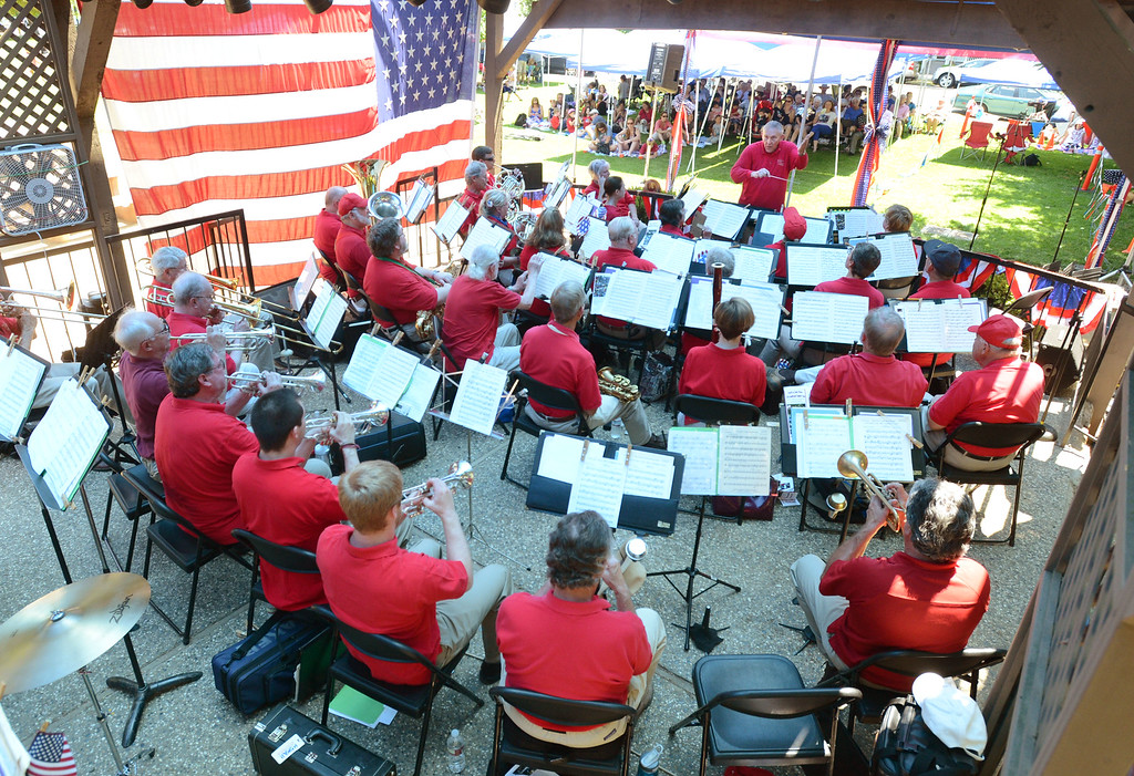 . Les Duman, leads the Pleasanton Community Concert Band during the 15th annual Fourth of July Picnic held at Lions Wayside Park in Pleasanton, Calif., on Thursday, July 4, 2013. The Independence Day celebration is sponsored by the Lions Club, Heritage Bank of Commerce, Raley\'s, and Accusplit stopwatches and pedometers. (Doug Duran/Bay Area News Group)