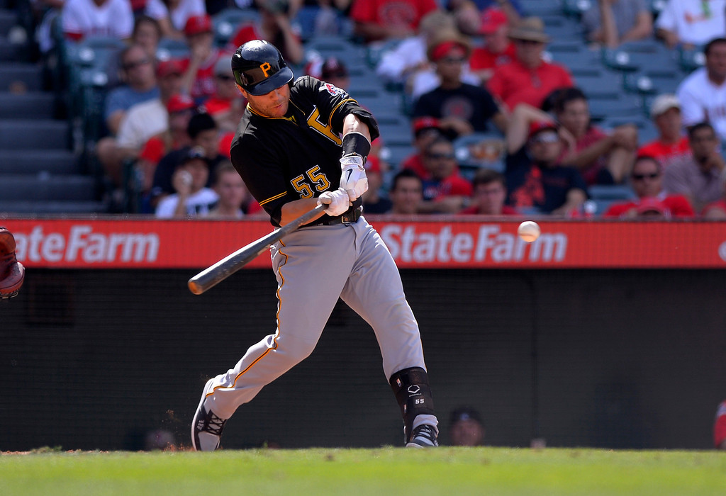 . Pittsburgh Pirates\' Russell Martin hits an RBI double during the ninth inning of their baseball game against the Los Angeles Angels, Sunday, June 23, 2013, in Anaheim, Calif.  (AP Photo/Mark J. Terrill)