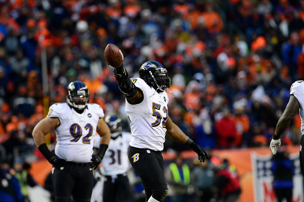 . Baltimore Ravens inside linebacker Ray Lewis (52) celebrates recovering a fumble in the third quarter but the play is called back for a Ravens penalty. The Denver Broncos vs Baltimore Ravens AFC Divisional playoff game at Sports Authority Field Saturday January 12, 2013. (Photo by AAron  Ontiveroz,/The Denver Post)