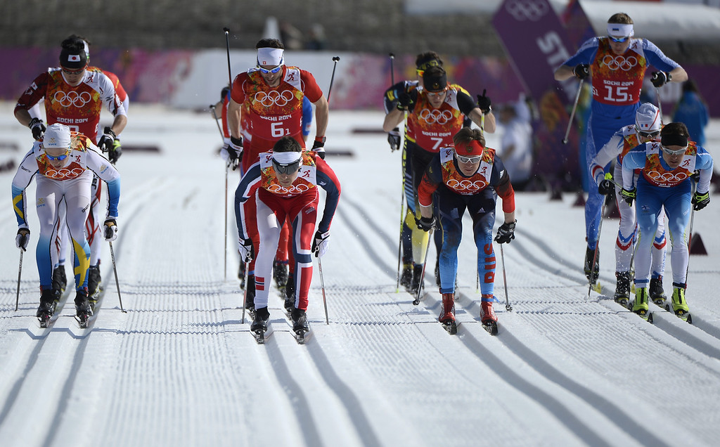 . Sweden\'s Lars Nelson, Norway\'s Eldar Roenning, Russia\'s Dmitriy Japarov and Finland\'s Sami Jauhojaervi start skiing at the start of the Men\'s Cross-Country Skiing 4 x 10km Relay at the Laura Cross-Country Ski and Biathlon Center during the Sochi Winter Olympics on February 16, 2014 in Rosa Khutor near Sochi. PIERRE-PHILIPPE MARCOU/AFP/Getty Images