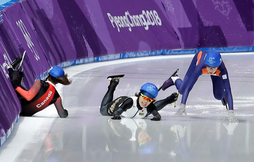 . Ivanie Blondin of Canada, Ayano Sato of Japan, and Annouk van der Weijden of The Netherlands, from left to right, crash during the women\'s mass start speedskating race at the Gangneung Oval at the 2018 Winter Olympics in Gangneung, South Korea, Saturday, Feb. 24, 2018. (AP Photo/Petr David Josek)