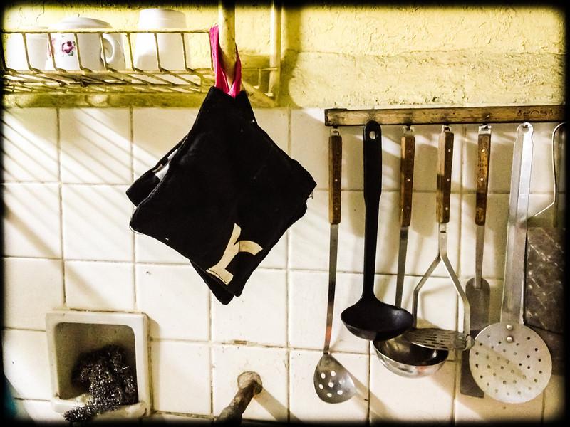 kitchen utensils above the sink