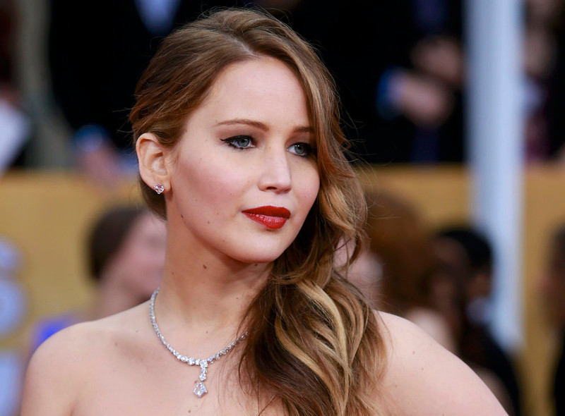 """. Actress Jennifer Lawrence, from the film \""""Silver Linings Playbook,\"""" arrives at the 19th annual Screen Actors Guild Awards in Los Angeles, California January 27, 2013.  REUTERS/Adrees Latif"""