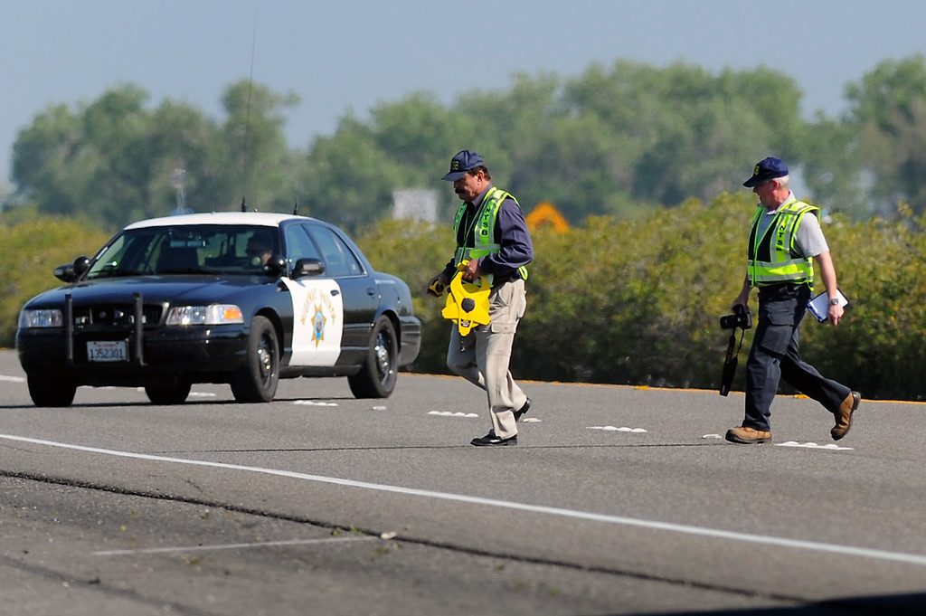 . NTSB personnel investigate the scene of the collision between the FedEx truck and the bus on the I-5, Saturday, April 12, 2014, in Orland, Ca. (Photo by Michael Owen Baker/L.A. Daily News)