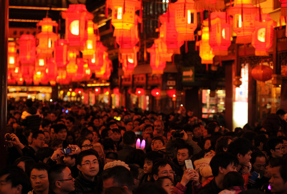 Description of . Visitors look at lanterns in Yuyuan Gardens during the Lantern Festival  in Shanghai on February 24, 2013. China celebrates the traditional Lantern Festival which formally marks the end of celebrations for the Chinese Lunar New Year period, 15 days after it began, and is celebrated by viewing lanterns and setting off fireworks, among other activities. PETER PARKS/AFP/Getty Images
