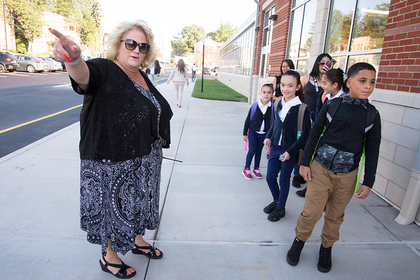 09/03/19 Wesley Bunnell | StaffrrSmalley School Principal Andrea Foligno points the way for students to gather before their first day of school on Tuesday September 3, 2019.