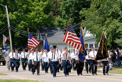 Veterans of Foreign Wars VFW local members proudly marching during the annual July 4 Holiday Parade in White Lake (USA WI White Lake)