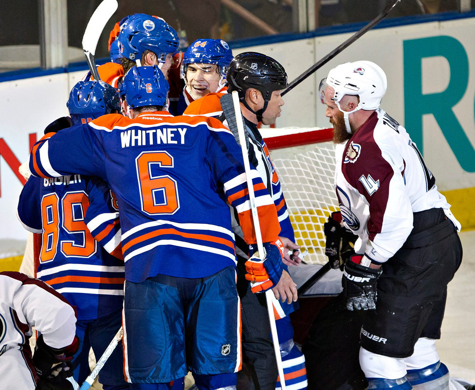 . Colorado Avalanche\'s Greg Zanon, right, watches as Edmonton Oilers\' Sam Gagner (89), Ryan Whitney (6), Teemu Hartikainen and Nail Yakupov celebrate a goal during the first period of their NHL hockey game, Monday, Jan. 28, 2013, in Edmonton, Alberta. (AP Photo/The Canadian Press, Jason Franson)