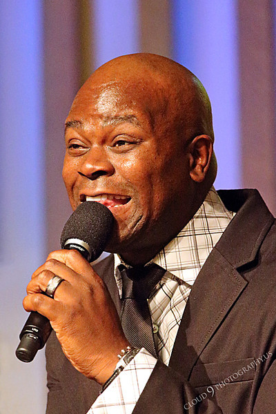 AMER-CMM 00095 Heritage Singers Tim Calhoun smiles during a performance by Peter J Mancus.jpg