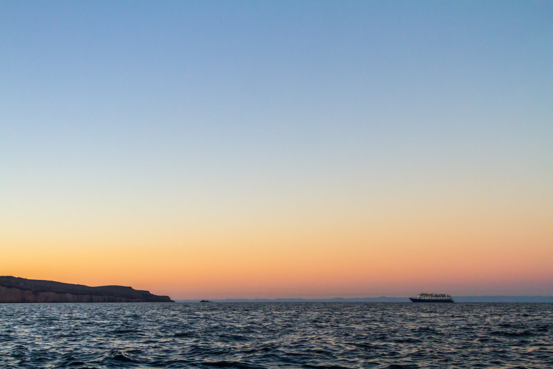 Distant view of ship sailing at dusk - Mexico