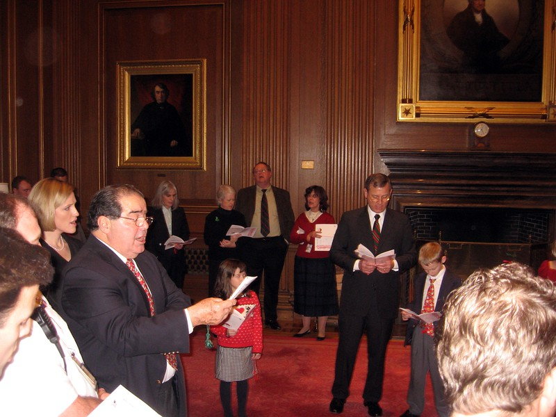 Chief Justice John Roberts and Associate Justice Antonin Scalia lead Christmas carols