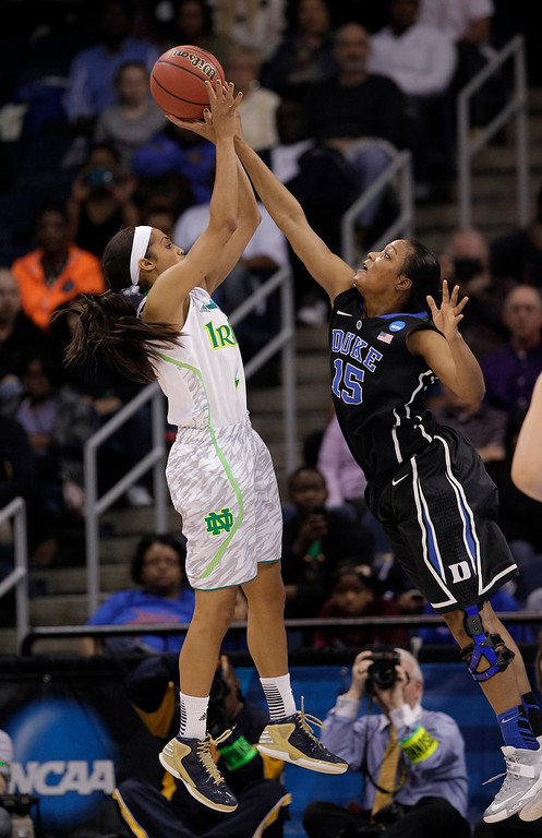 . Duke forward Richa Jackson (15) blocks a shot by Notre Dame guard Skylar Diggins during the first half of the regional final game of the NCAA women\'s college basketball tournament Tuesday, April 2, 2013, in Norfolk, Va. (AP Photo/Steve Helber)