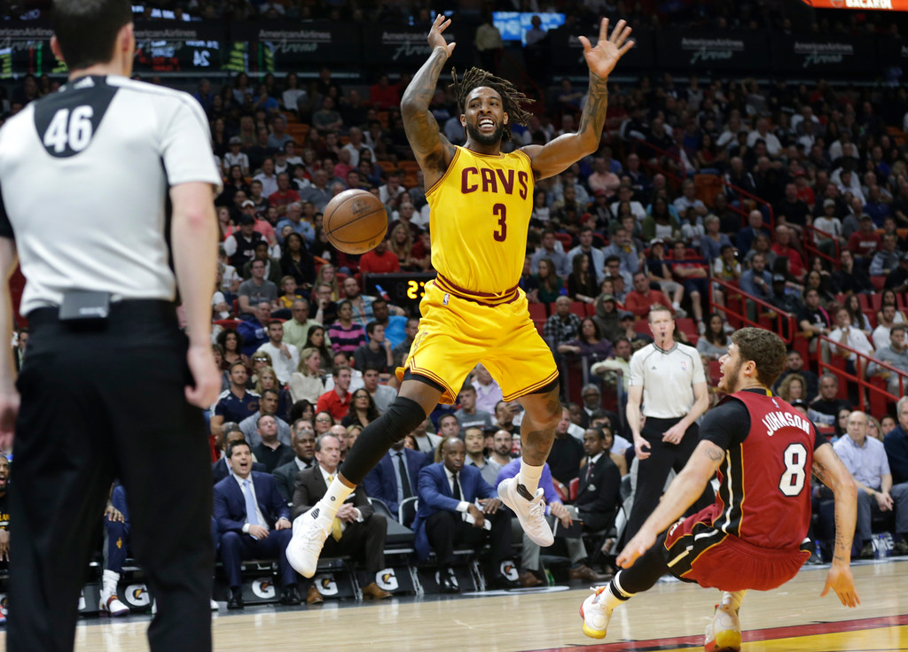 . Cleveland Cavaliers\' Derrick Williams (3) loses the ball as he is fouled by Miami Heat\'s Tyler Johnson (8) during the first half of an NBA basketball game, Saturday, March 4, 2017, in Miami. (AP Photo/Lynne Sladky)