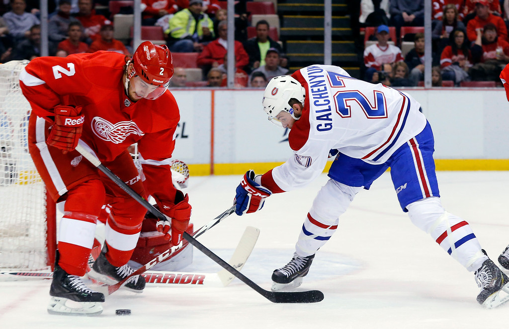 . Montreal Canadiens center Alex Galchenyuk (27) tries to shoot as Detroit Red Wings defenseman Brendan Smith (2) defends in the second period of an NHL hockey game in Detroit Sunday, Nov. 16, 2014. (AP Photo/Paul Sancya)