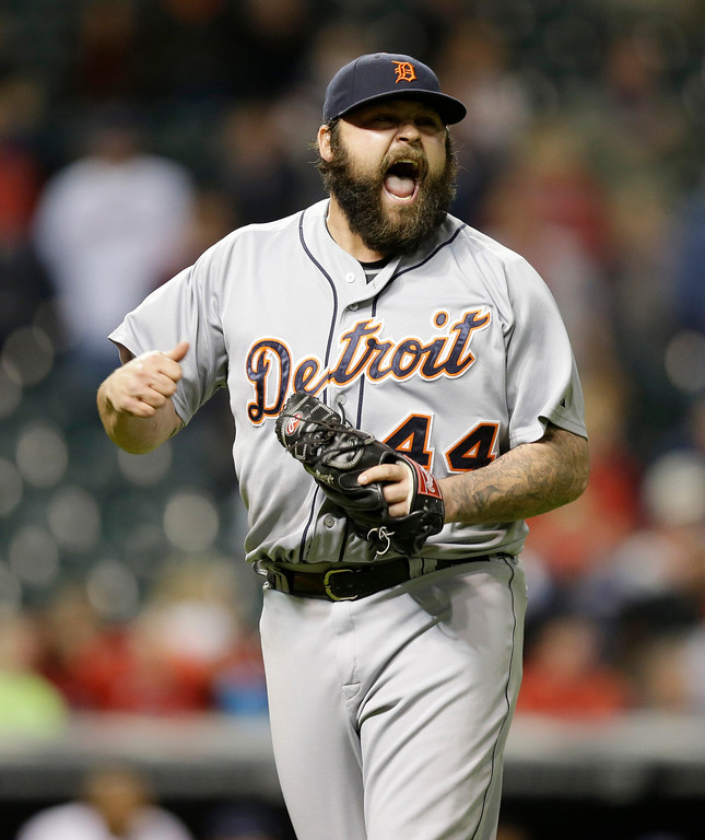 . Detroit Tigers relief pitcher Joba Chamberlain reacts after a double play to end the ninth inning of a baseball game against the Cleveland Indians, Monday, May 19, 2014, in Cleveland. (AP Photo/Tony Dejak)