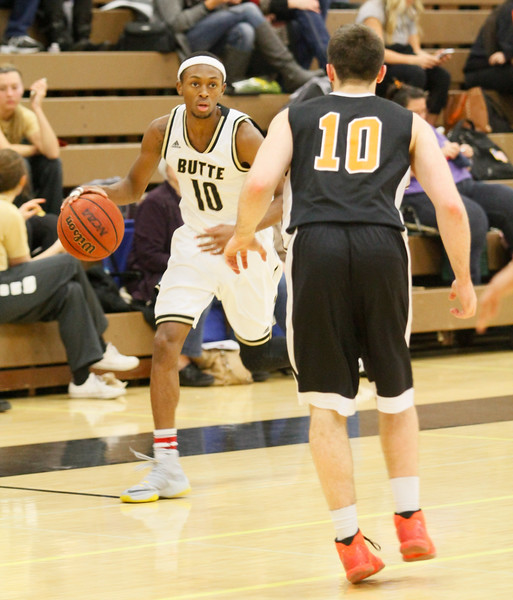 Butte College's Josias Parker plans comes one-on-one with Lassen's Danny Spinuzza during a men's basketball February 15, 2017 at Butte College in Oroville, California. (Emily Bertolino -- Enterprise-Record)