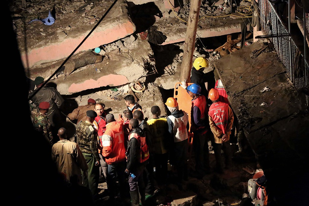 . Emergency personnel look for survivors trapped under the rubble of a building that collapsed in Nairobi late on April 29, 2016. / AFP PHOTO / --/AFP/Getty Images
