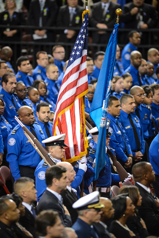 . TSA officers bring in the flag for the memorial for slain TSA officer Gerardo Hernandez at the Los Angeles Sports Arena Tuesday, November 12, 2013.  A public memorial was held for Officer Hernandez who was killed at LAX when a gunman entered terminal 3 and opened fire with a semi-automatic rifle, Grigsby was wounded in the attack.  ( Photo by David Crane/Los Angeles Daily News )
