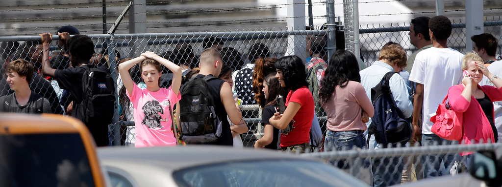 . Students wait to leave Spring High School Wednesday, Sept. 4, 2013, in Spring, Texas.  (AP Photo/David J. Phillip)