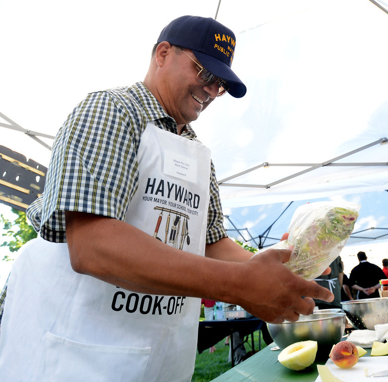 ". Hayward Mayor Pro Tem Mark Salinas, prepares a chicken marinade during the ""Alameda County Mayors\' Healthy Cook-Off Challenge\"" held at the Dublin Farmers\' Market at Emerald Glen Park in Dublin, Calif., on Thursday, July 25, 2013. The Hayward team, consisting of Chef Tony Solorio with the Hayward\'s Tacos Uruapan restaurant, went on to place second, advancing them to compete against the winners of the Contra Cost County Mayors\' Healthy Cook-Off Challenge. The contest will be held at Mt. Diablo High School in the fall. The cook-off was presented by Concord\'s Wellness City Challenge and promotes the importance of healthy eating. (Doug Duran/Bay Area News Group)"