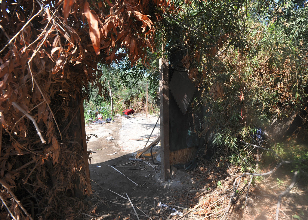 . Los Angeles County Sheriff\'s Deputies search the homeless camp in the river bed area of the San Gabriel River near South El Monte on Thursday September 12, 2013. (Whittier Daily News/Staff Photo by Keith Durflinger)