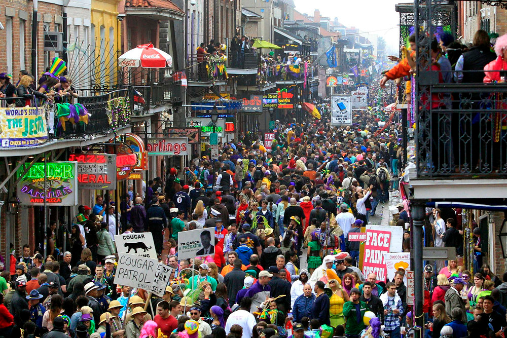 Description of . Crowds flood Bourbon Street on Mardi Gras Day in New Orleans, Louisiana February 12, 2013. REUTERS/Sean Gardner