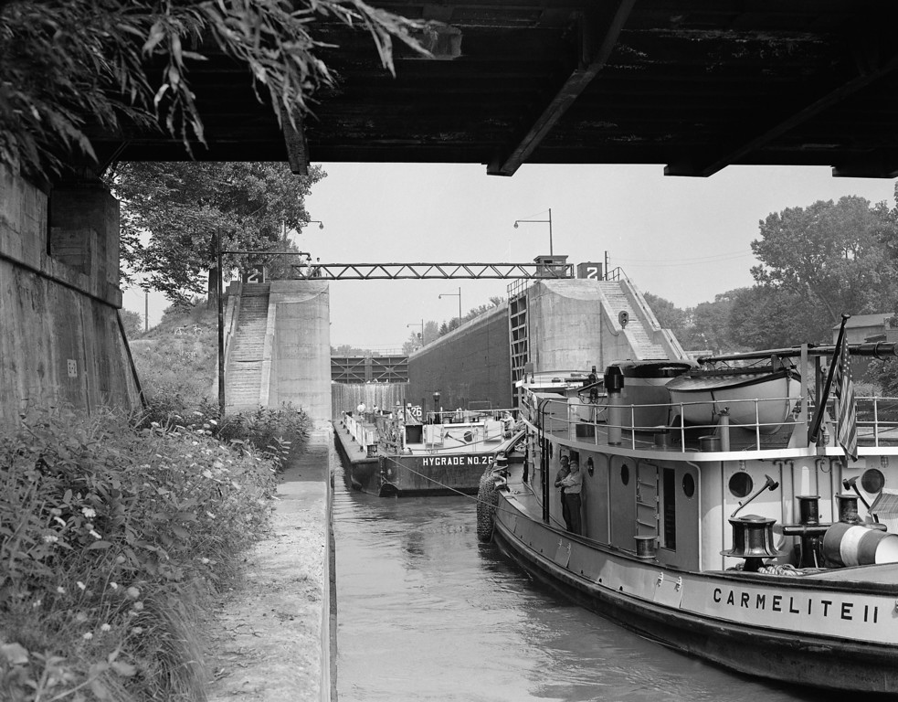 . In this Sept. 4, 1947 file photo, an oil-loaded barge is pushed into lock two near Waterford, N.Y., as it starts its westward journey on the Erie Canal. Ground was broken for the Erie Canal 200 years ago, and when the 363-mile canal fully opened in 1825, it was the greatest engineering feat of the era and one that would change history. (AP Photo, File)