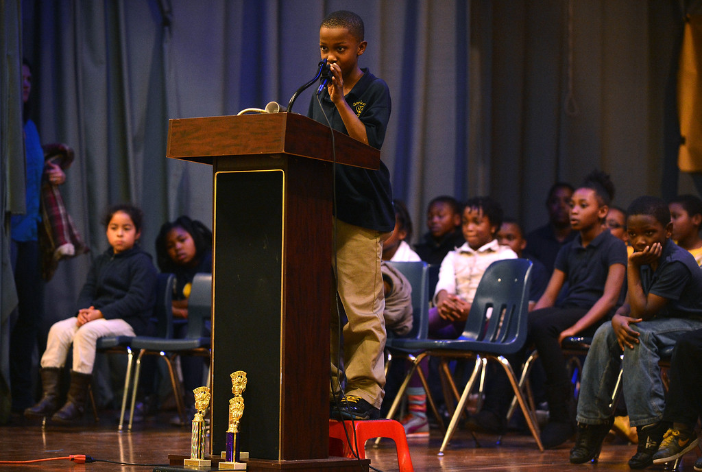 . Sankofa Academy third-grader Amani Johnson steps up to the microphone as he participates in the school\'s second annual spelling bee in Oakland, Calif. on Wednesday, Jan. 23, 2013. Sankofa Academy sixth-grader Adam Ansari won the event and will move on to represent Sankofa\'s middle school class at the district level spelling bee in February, while fifth-grader Aisha Ramsey, with a second place finish, will represent the elementary grades. (Kristopher Skinner/Staff)